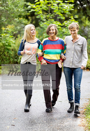 Three generation females walking on street Stock Photo - Premium Royalty-Free, Image code: 698-07587925