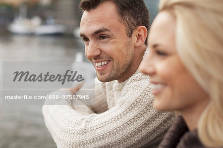 Happy young couple outdoors Stock Photo - Premium Royalty-Free, Image code: 698-07587945