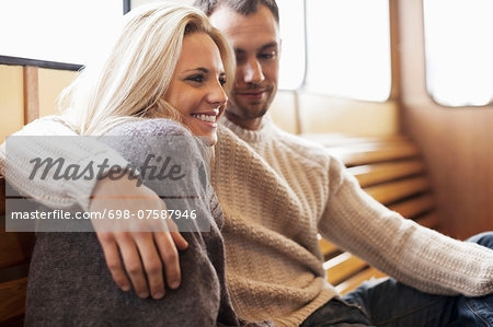 Romantic young couple sitting on ferry Stock Photo - Premium Royalty-Free, Image code: 698-07587946