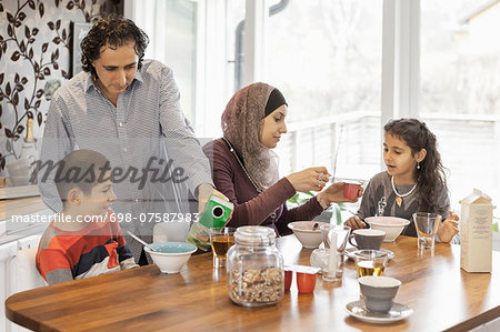 Family having breakfast together at home Stock Photo - Premium Royalty-Free, Image code: 698-07587983