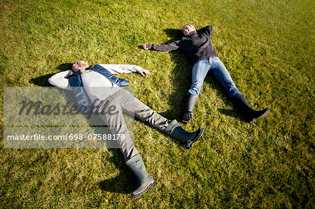 High angle view of mature couple lying on grass Stock Photo - Premium Royalty-Free, Image code: 698-07588179