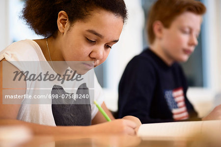 High school girl studying in class Stock Photo - Premium Royalty-Free, Image code: 698-07588240