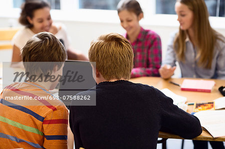 High school students using laptop in classroom Stock Photo - Premium Royalty-Free, Image code: 698-07588262