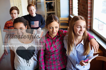 High school students in locker room Stock Photo - Premium Royalty-Free, Image code: 698-07588293
