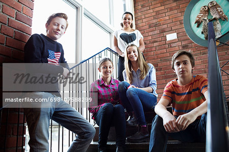Portrait of confident friends on high school steps Stock Photo - Premium Royalty-Free, Image code: 698-07588299