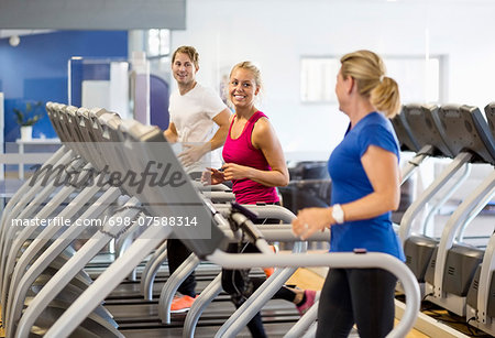 Friends exercising on treadmills at health club Stock Photo - Premium Royalty-Free, Image code: 698-07588314