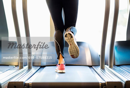 Low section of woman exercising on treadmill Stock Photo - Premium Royalty-Free, Image code: 698-07588315