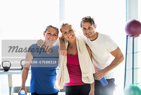 Portrait of happy friends at health club Stock Photo - Premium Royalty-Free, Image code: 698-07588319