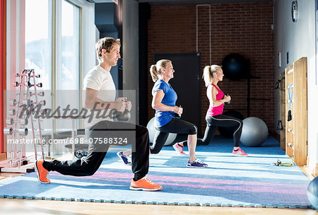 People exercising with kettlebells at gym Stock Photo - Premium Royalty-Free, Image code: 698-07588324