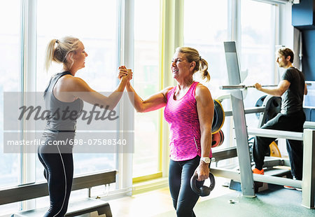 Happy women at health club Stock Photo - Premium Royalty-Free, Image code: 698-07588340