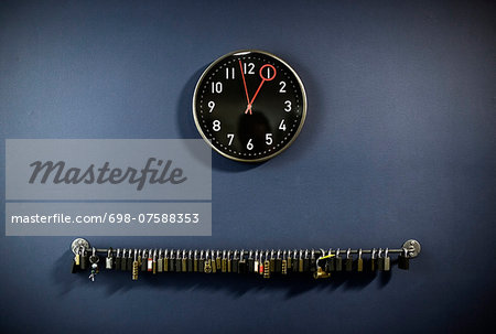 Padlocks hanging on railing with clock at gym's locker room Stock Photo - Premium Royalty-Free, Image code: 698-07588353