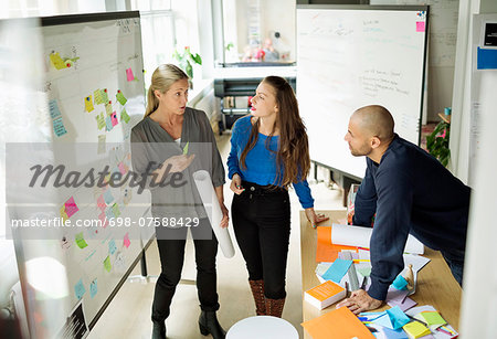Business people discussing in creative office Stock Photo - Premium Royalty-Free, Image code: 698-07588429