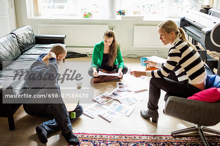 Business people conversing in creative office Stock Photo - Premium Royalty-Free, Image code: 698-07588430