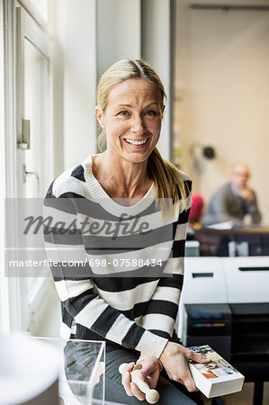 Portrait of confident businesswoman in creative office Stock Photo - Premium Royalty-Free, Image code: 698-07588434