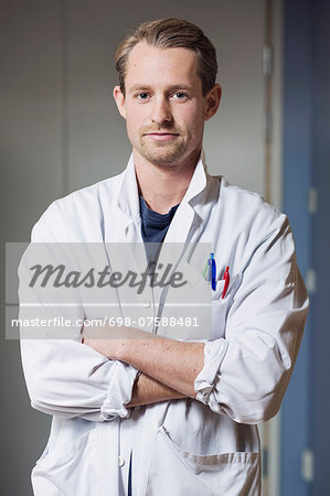 Portrait of confident male doctor with arms crossed in hospital Stock Photo - Premium Royalty-Free, Image code: 698-07588481