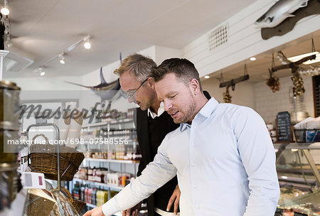Businessmen selecting food at cafe Stock Photo - Premium Royalty-Free, Image code: 698-07588556