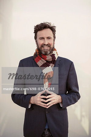 Portrait of confident businessman standing in hotel Stock Photo - Premium Royalty-Free, Image code: 698-07611593