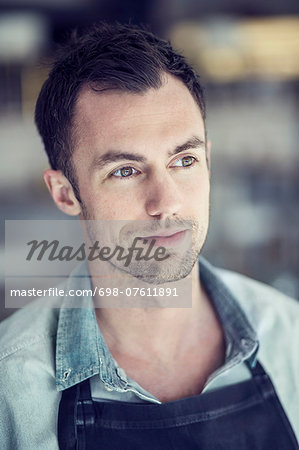Cafe owner looking away Stock Photo - Premium Royalty-Free, Image code: 698-07611891