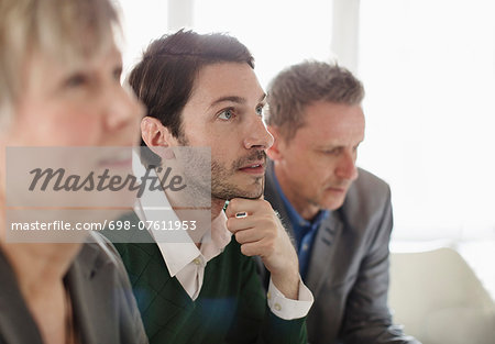 Businessman with colleagues in office Stock Photo - Premium Royalty-Free, Image code: 698-07611953