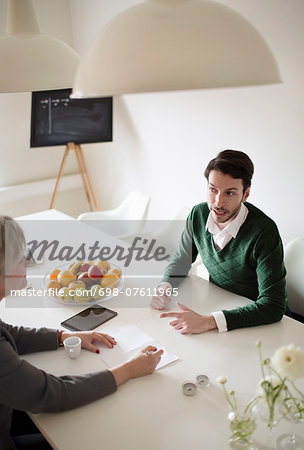 High angle view of business people in meeting Stock Photo - Premium Royalty-Free, Image code: 698-07611965