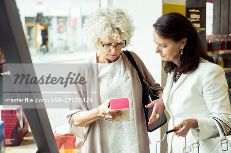 Senior women reading label on product in store Stock Photo - Premium Royalty-Free, Image code: 698-07635429