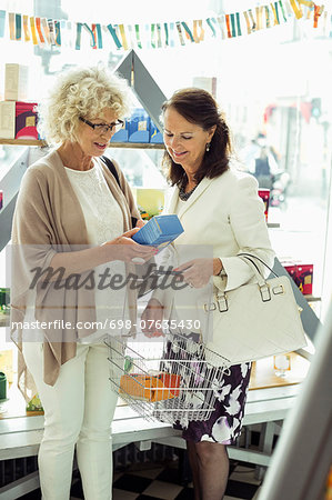 Senior female friends shopping in store Stock Photo - Premium Royalty-Free, Image code: 698-07635430