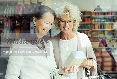 Senior women checking instructions on product in store Stock Photo - Premium Royalty-Free, Image code: 698-07635432