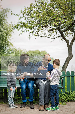 Full length of male homosexual family spending leisure time at park Stock Photo - Premium Royalty-Free, Image code: 698-07635538
