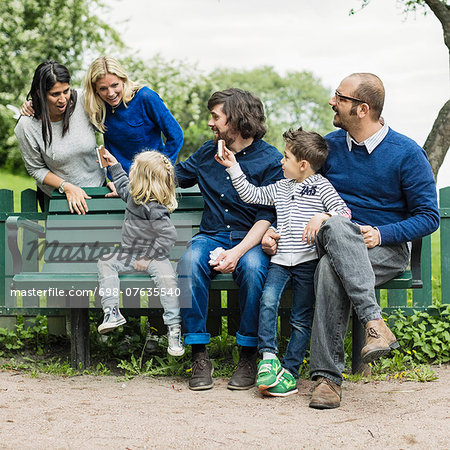 Homosexual families spending leisure time in park Stock Photo - Premium Royalty-Free, Image code: 698-07635540