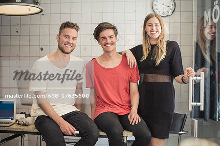 Portrait of confident new business team in creative office Stock Photo - Premium Royalty-Free, Image code: 698-07635600