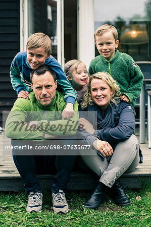 Portrait of happy family on porch Stock Photo - Premium Royalty-Free, Image code: 698-07635677