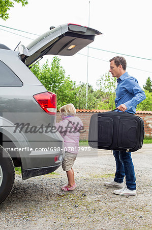 Father and daughter getting ready for road trip Stock Photo - Premium Royalty-Free, Image code: 698-07812975