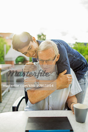 Happy young man embracing grandfather at yard Stock Photo - Premium Royalty-Free, Image code: 698-07813004