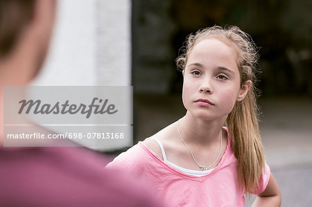 Angry girl looking at father outdoors Stock Photo - Premium Royalty-Free, Image code: 698-07813168