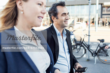 Businesspeople looking away while walking on street Stock Photo - Premium Royalty-Free, Image code: 698-07944666