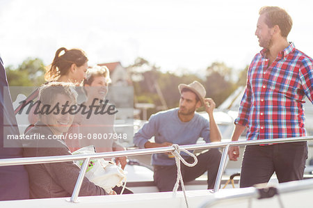 Happy friends enjoying on yacht Stock Photo - Premium Royalty-Free, Image code: 698-08007848