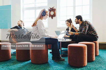 Business people in meeting at creative office Stock Photo - Premium Royalty-Free, Image code: 698-08081652