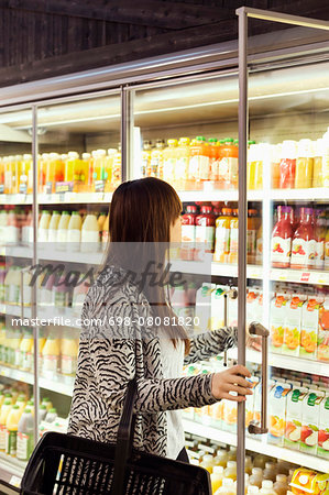 Woman shopping at freezer section in supermarket Stock Photo - Premium Royalty-Free, Image code: 698-08081820