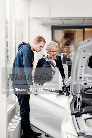 Mother and son looking at car in dealership shop Stock Photo - Premium Royalty-Free, Image code: 698-08170913
