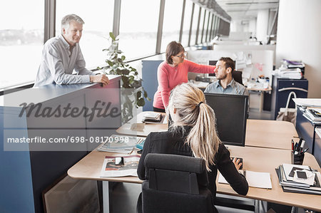 Business people discussing in office Stock Photo - Premium Royalty-Free, Image code: 698-08170998