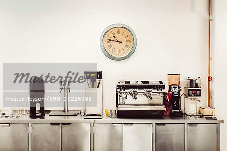Various coffee makers on commercial kitchen counter Stock Photo - Premium Royalty-Free, Image code: 698-08226388