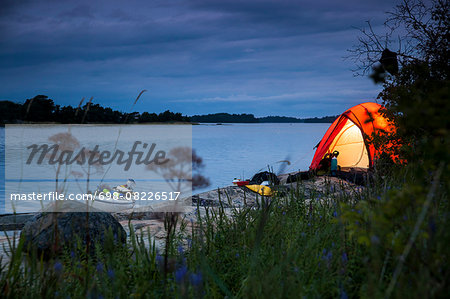 Tent at lakeshore during dusk Stock Photo - Premium Royalty-Free, Image code: 698-08226517