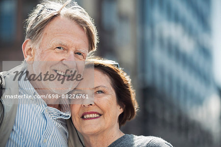 Happy senior couple looking away outdoors Stock Photo - Premium Royalty-Free, Image code: 698-08226761