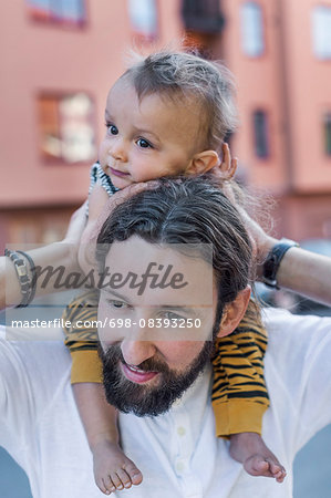 Mid adult man carrying son on shoulders outdoors Stock Photo - Premium Royalty-Free, Image code: 698-08393250