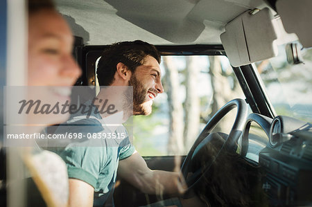 Side view of happy couple enjoying road trip Stock Photo - Premium Royalty-Free, Image code: 698-08393515