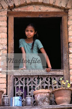 Girl Standing at Window Nepal Stock Photo - Rights-Managed, Image code: 700-00002192