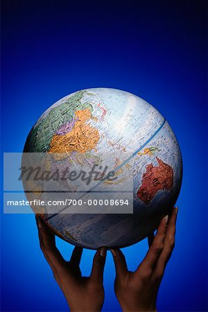Hands Holding Globe Pacific Rim Stock Photo - Rights-Managed, Image code: 700-00008694