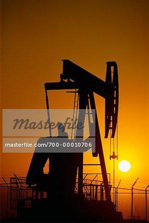 Silhouette of Oil Pump Jack at Sunset Long Beach, California, USA