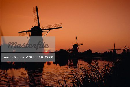 Silhouette of Windmills at Sunset The Netherlands Stock Photo - Rights-Managed, Image code: 700-00012660