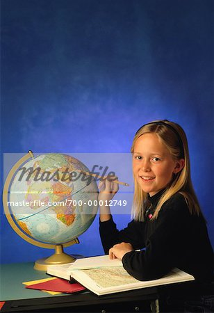 Student with Globe and Atlas Stock Photo - Rights-Managed, Image code: 700-00012749